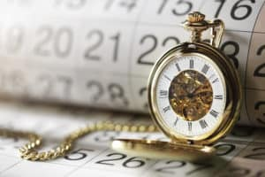 Actuarially Sound:  Different Meanings in Different States Gold pocket watch and calendar