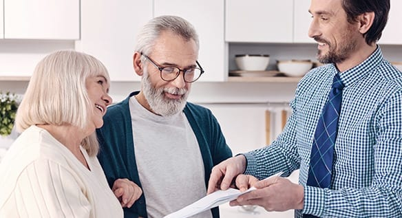 Elderly Couple Working With Financial Planner